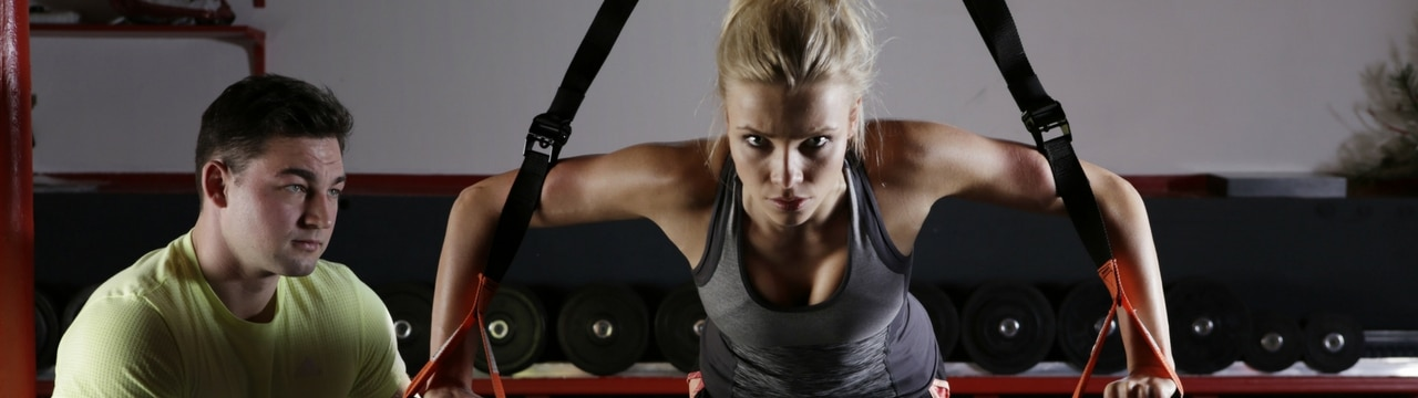 blackburn personal training coach with female client on TRX